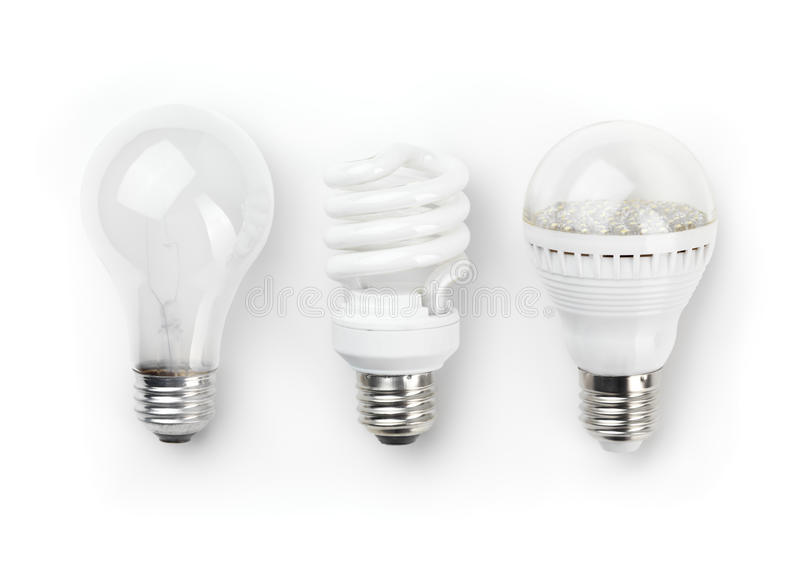 LED Fluorescent and Incandescent Light Bulbs. Three generations of light bulbs. Regular incandescent, energy saving fluorescent and LED isolated on white stock photo
