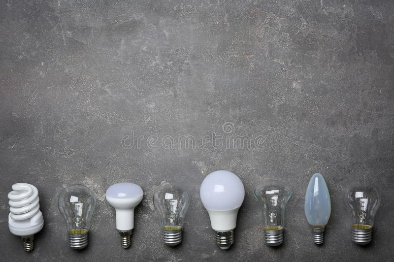 LED, incandescent and fluorescent lamps. On grey background stock photography
