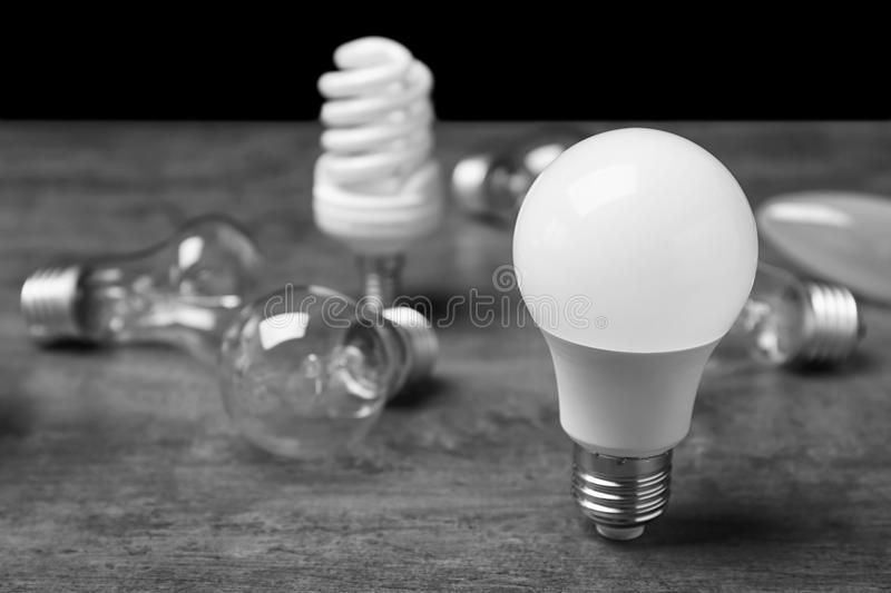 LED, incandescent and fluorescent lamps. On table royalty free stock image