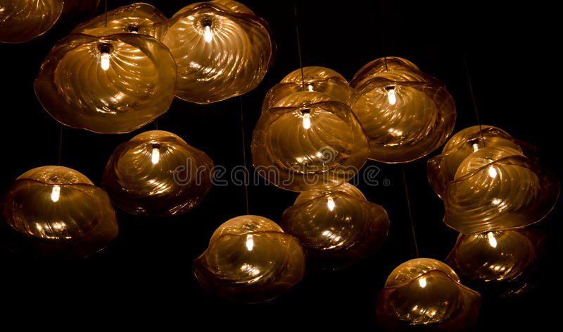 LED lamp. Glowing LED lamp on black background stock photography