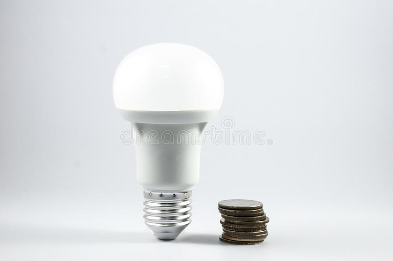 LED lamp and money. royalty free stock photography