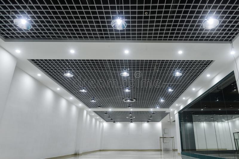 Led ceiling lights on modern commercial building ceiling stock photo download led ceiling lights on modern commercial building ceiling stock photo image of blurred mozeypictures Image collections