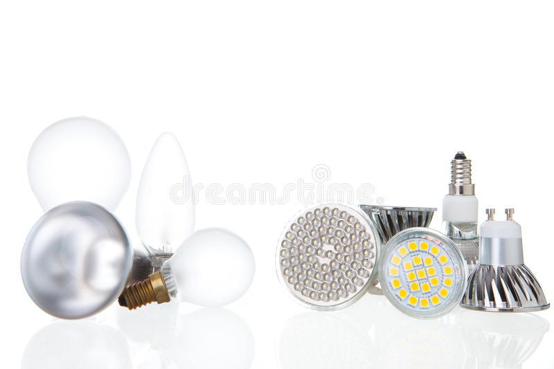 LED lamps versus conventional lamps on white. LED energy saving lamps versus conventional lamps in comparison on white background royalty free stock photography