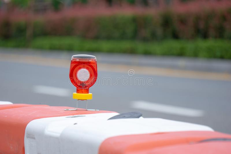 LED light blub attached to street barriers royalty free stock image