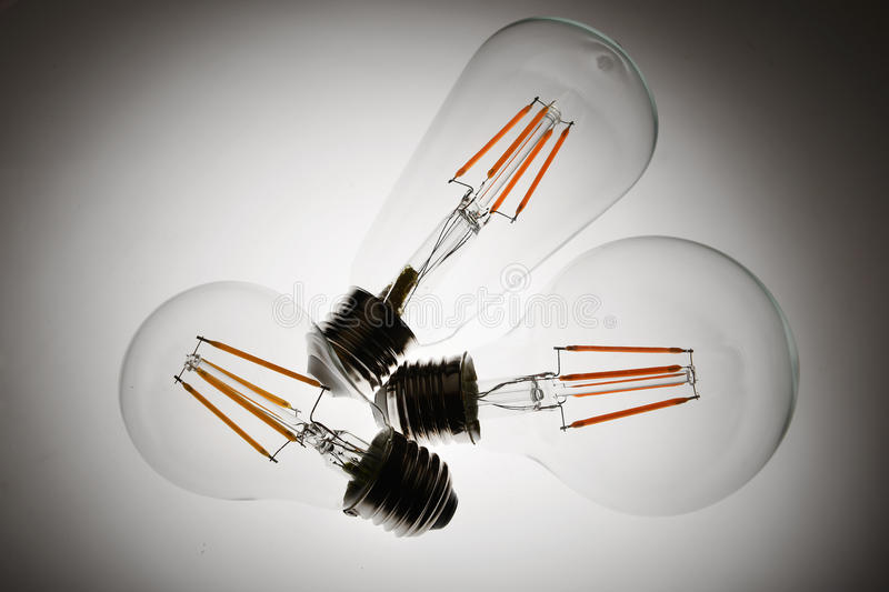 Led light bulb. New type led lamp bulb on white background.three generations of light bulb such as regular incandescent lamp bulb, energy saving fluorescent lamp royalty free stock images