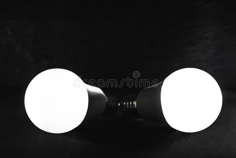 Led light bulbs white light on black textured background stock photo