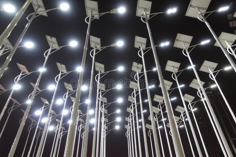 Led solar street lamp at night. Led light used in modern construction, subway station, airport, railway station, bus station ,shopping mall,office,shopping mall royalty free stock image
