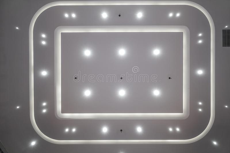 Led light system on modern building ceiling. Led light used in modern construction, subway station, airport, railway station, bus station ,shopping mall,office stock images
