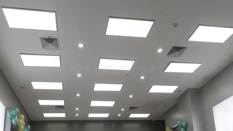 Led panel lamp on modern office ceiling. Led light used in modern construction, subway station, airport, railway station, bus station ,shopping mall,office royalty free stock photo