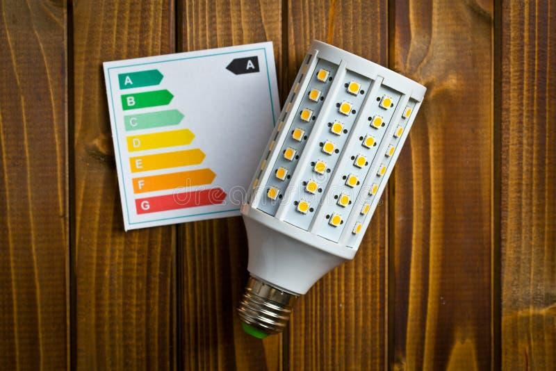 LED lightbulb with energy label stock image