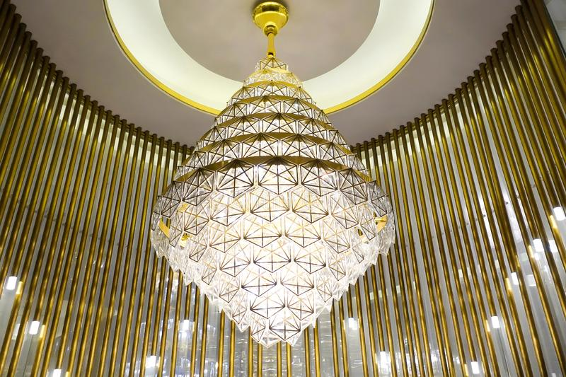 Led lighting chandelier lamp in modern commercial building hotel hall stock photo