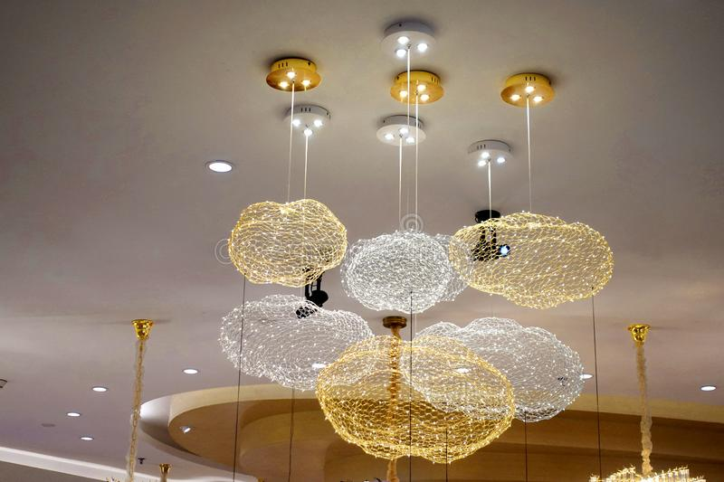 led lighting chandelier lamp in modern commercial building stock photography