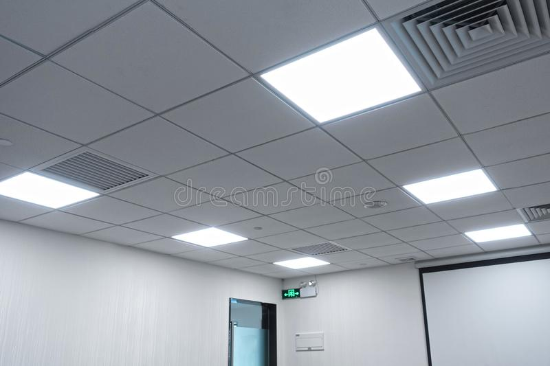 Led panel lamp on modern office ceiling. Led light used in modern construction, subway station, airport, railway station, bus station ,shopping mall,office stock photography
