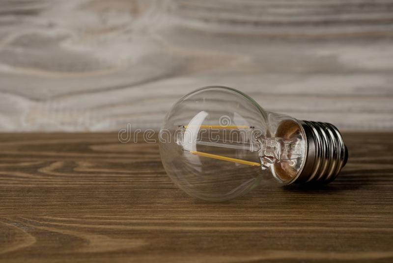 LED power lamp electricity light bulb wood background stock photos