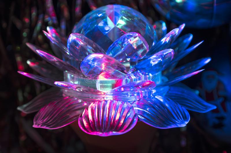 LED rotating lamp. Rotating lamp in the form of a lotus, which shines in three colors. The original lamp design is an indispensable attribute that gives a stock images