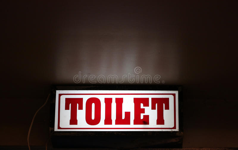 LED signs provide directional. LED signs provide directional to the toilet royalty free stock image