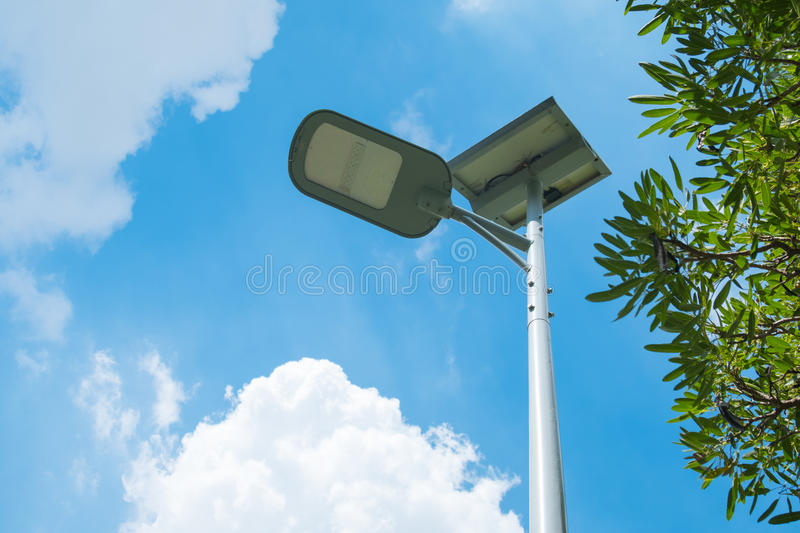 LED spotlight with solar power in street garden and blue sky background.  stock image