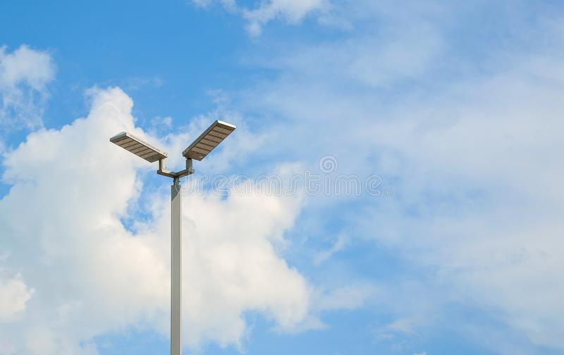 LED street lamps with energy-saving technology, cloud on sky background.  stock photo