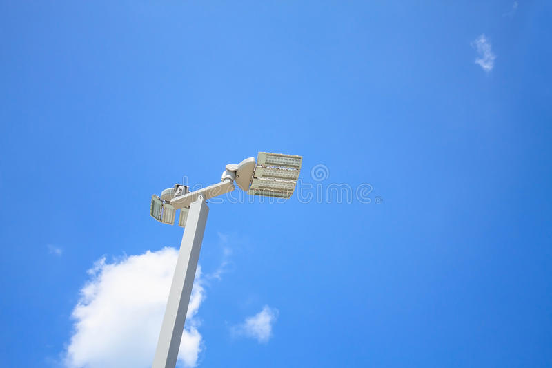 LED street lamps with energy-saving technology. Cloud on sky background stock photo