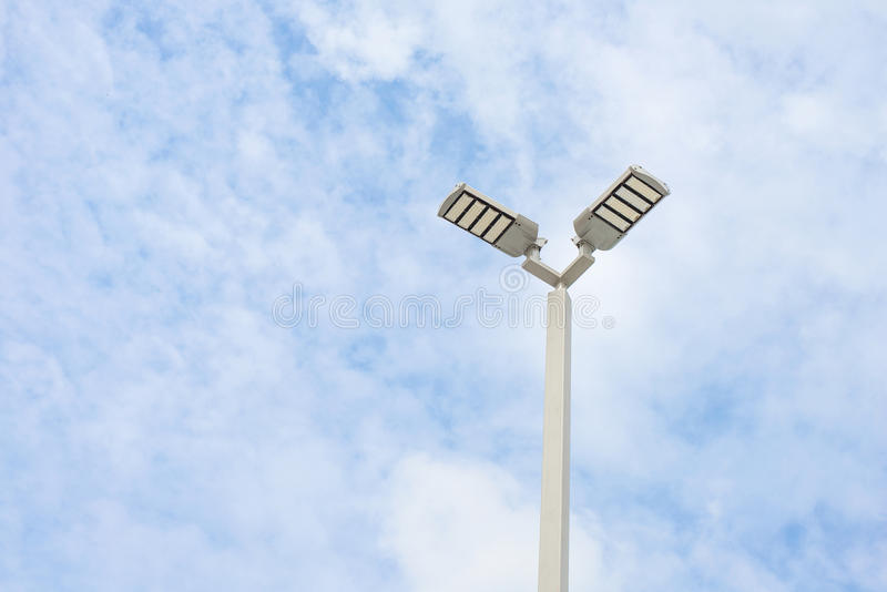 LED street lamps with energy-saving technology,. Cloud on sky background stock photo