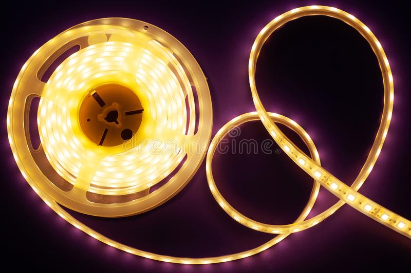LED strip on a dark purple background, diode light. Close-up royalty free stock photo