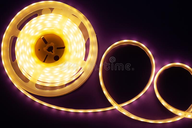 LED strip on a dark purple background, diode light. Close-up stock photos