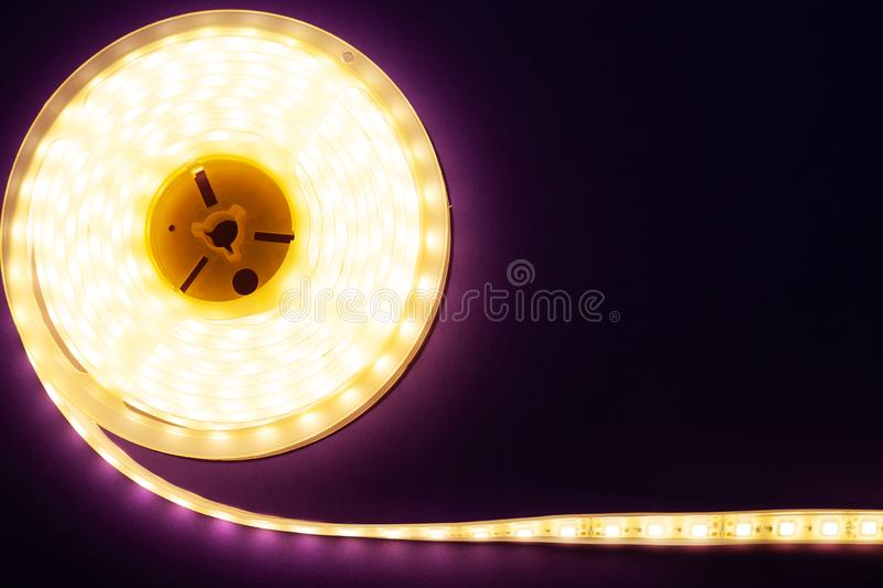 LED strip on a dark purple background, diode light copy space. Close-up royalty free stock photography