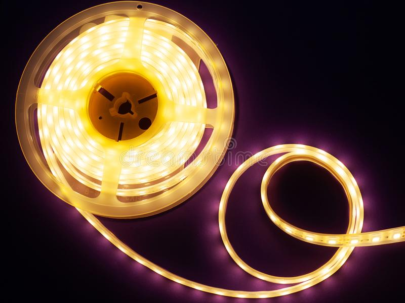 LED strip on a dark purple background, diode light. Close-up royalty free stock photography