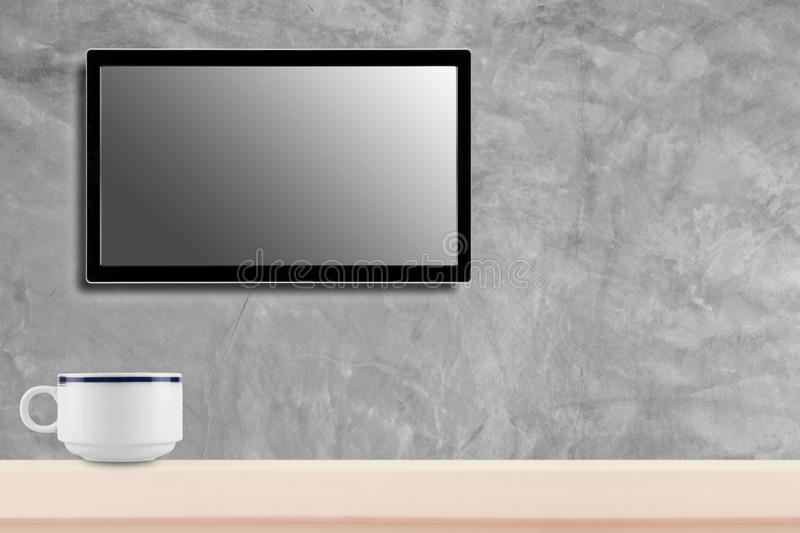LED television screen mockup, blank hdtv on concrete wall with coffee cup in the room stock photo