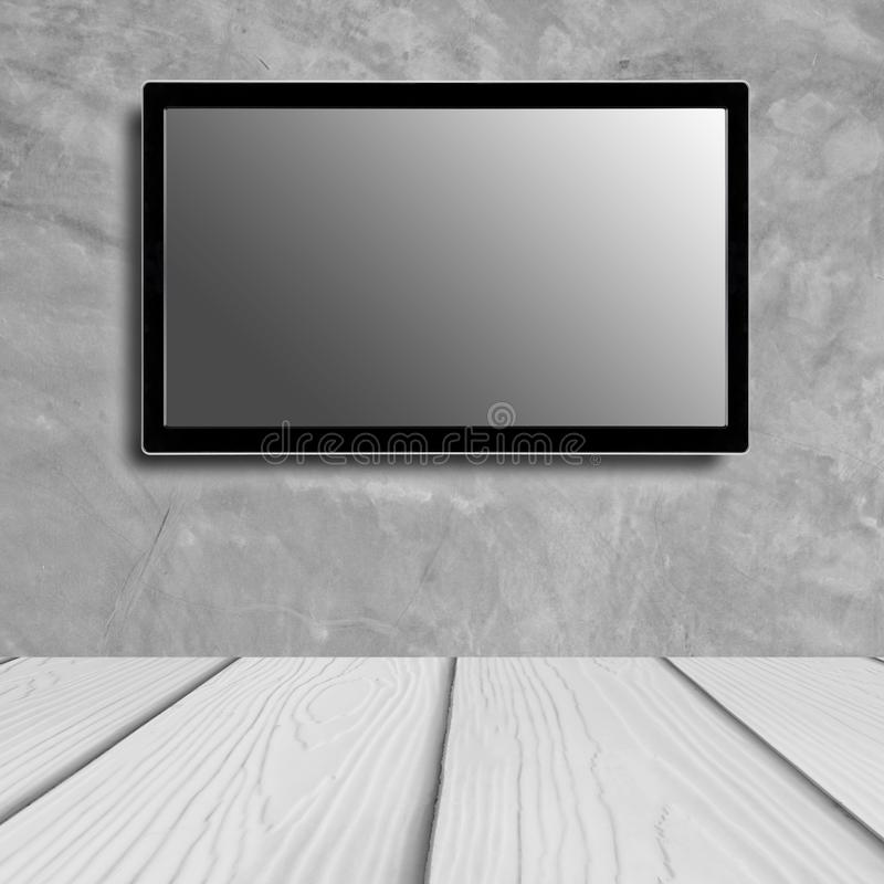 LED television screen mockup, blank hdtv on concrete wall in the room royalty free stock photography