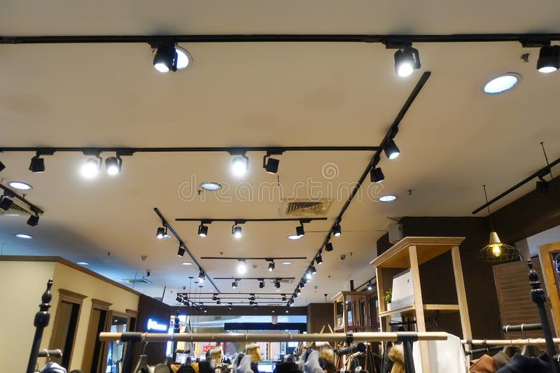 Led track light on fashion shop ceiling. Led light used in modern construction, subway station, airport, railway station, bus station ,shopping mall,office royalty free stock photos