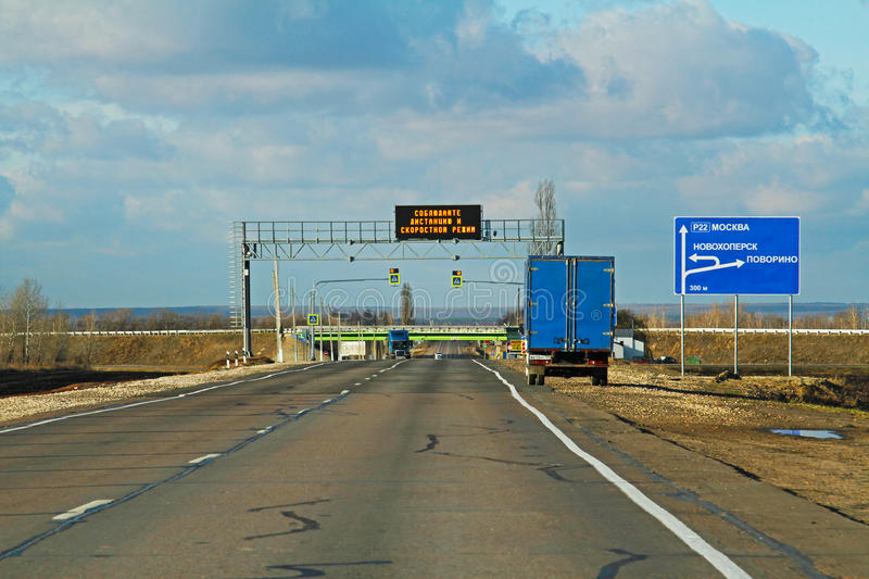 LED Traffic Road Sign translated from the Russian `Keep your distance and speed limit` on the track in Russia stock photography