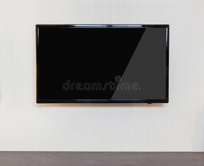 Modern living room with TV on the wall. royalty free stock photography