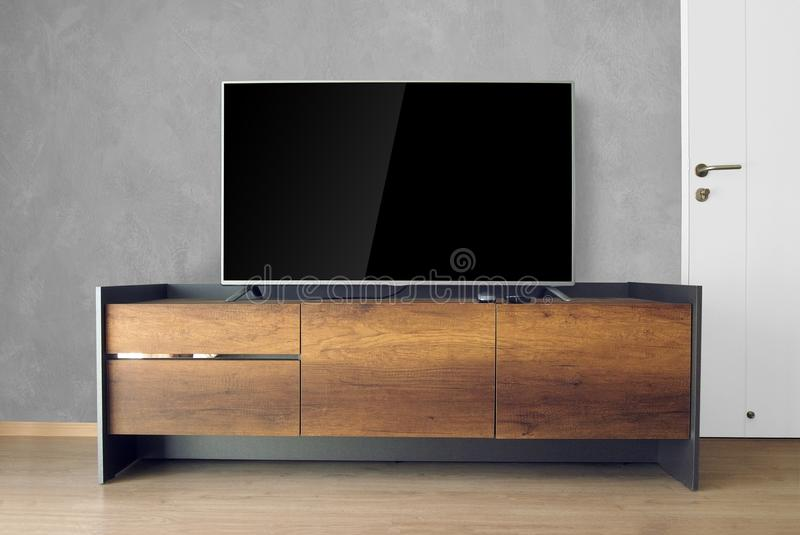 Led TV on TV stand in empty room with concrete wall. decorate in stock images