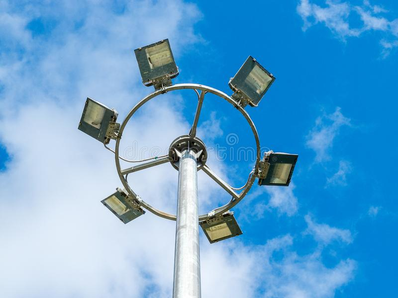 Led urban lighting lamp on a pole against the blue sky. Eco-friendly energy-saving technology in the urban environment stock photography