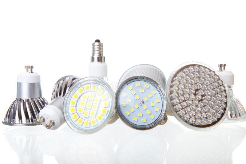 LEDDE lampor på vit arkivbilder