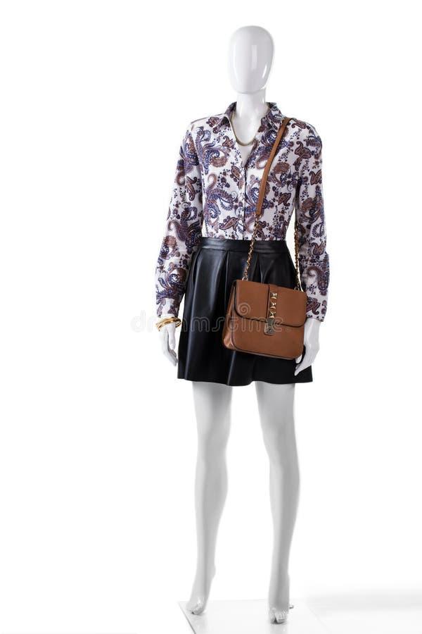 Ledenpop die rok en beurs dragen royalty-vrije stock afbeelding