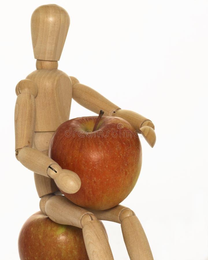 Ledenpop met appelen stock foto