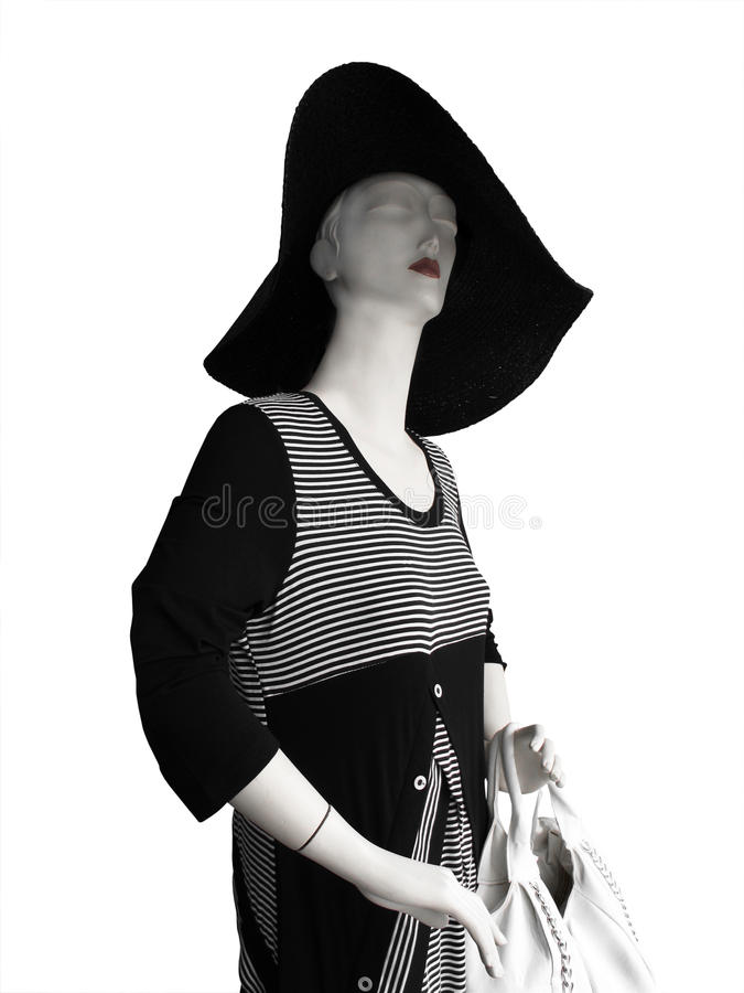 Ledenpop met grote hoed en zwart-witte kleding stock afbeelding