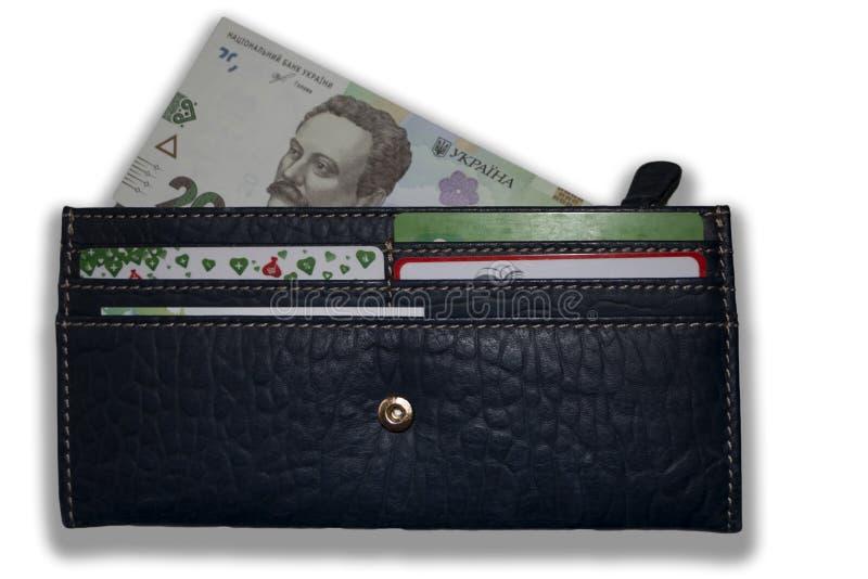 Lederne Geldbörse mit einem sichtbaren Teil der ukrainischen Banknote lizenzfreie stockfotos