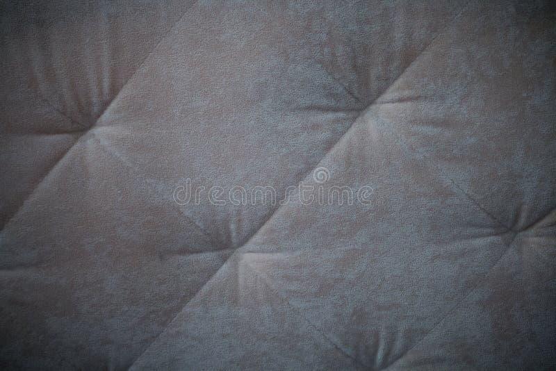 Lederner Sofa Texture Seamless Background, graues Polsterungssofa mit Einbuchtungen lizenzfreie stockfotografie