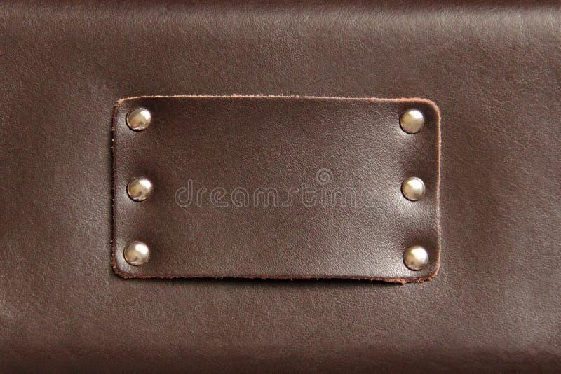 Ledernes Detail mit Metallnieten lizenzfreie stockbilder