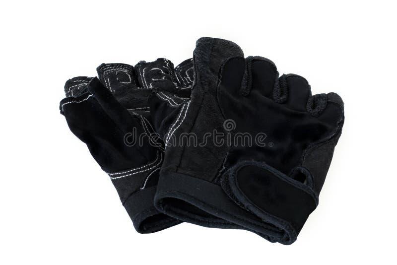 Ledernes schwarzes raues der Handschuhe verwendet auf Weiß lokalisierte Hintergrund stockfotografie