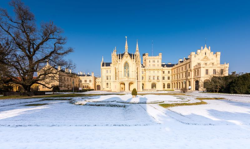 The Lednice castle panorama in snow, winter. Beautiful old historical architecture, blue sky. Czech republic unesco royalty free stock images