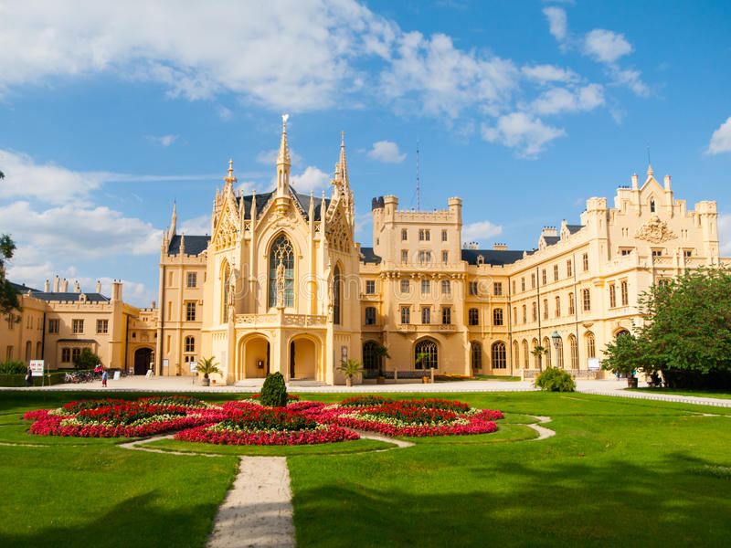 Lednice Chateau on summer day. Lednice Chateau in the English Neo-Gothic style with flower garden on summer day, Lednice-Valtice Cultural Landscape, Czech royalty free stock photos