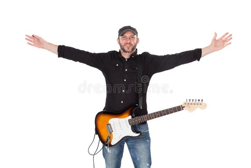 Ledningsgitarrist med den elektriska gitarren som isoleras på vit arkivbild