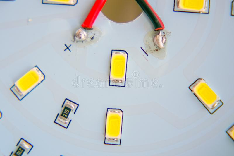 LEDs close-up on a printed circuit board. LED lamp inside view. LEDs close-up on a printed circuit board. Soft focus. Selective focus royalty free stock image