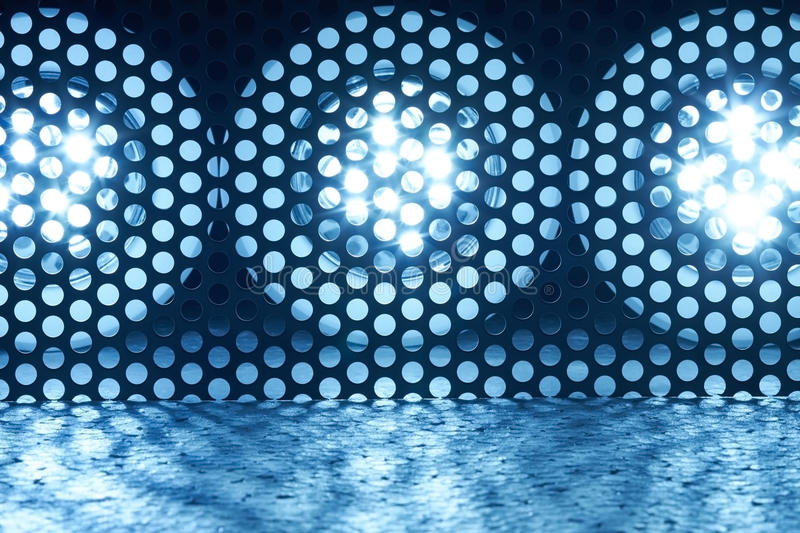 LEDs. Three bright LED lights are behind a lattice royalty free stock image