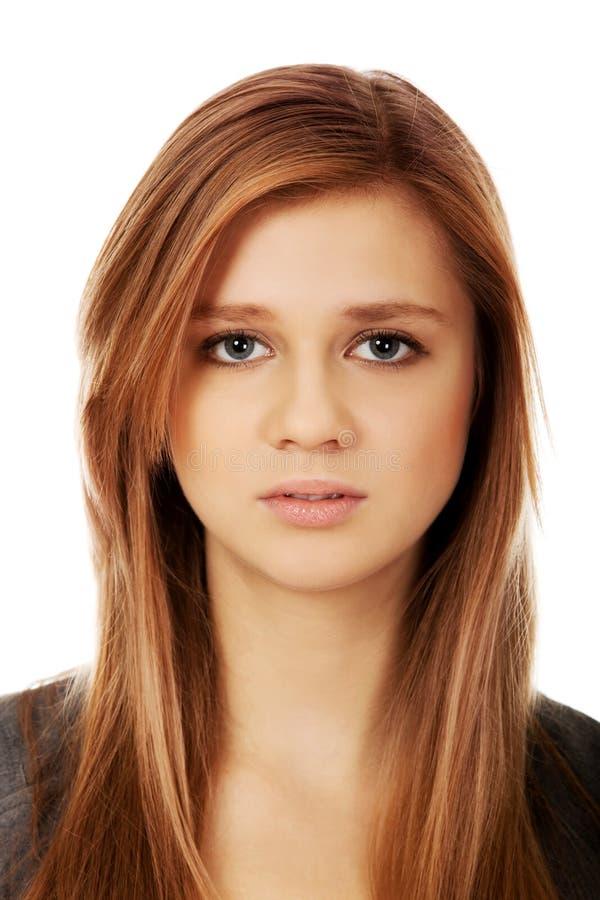 Ledsen eller bekymrad tonårs- nätt kvinna royaltyfria foton