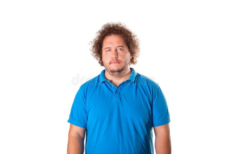 Ledsen fet man som poserar i studion Hälsoproblem arkivbilder